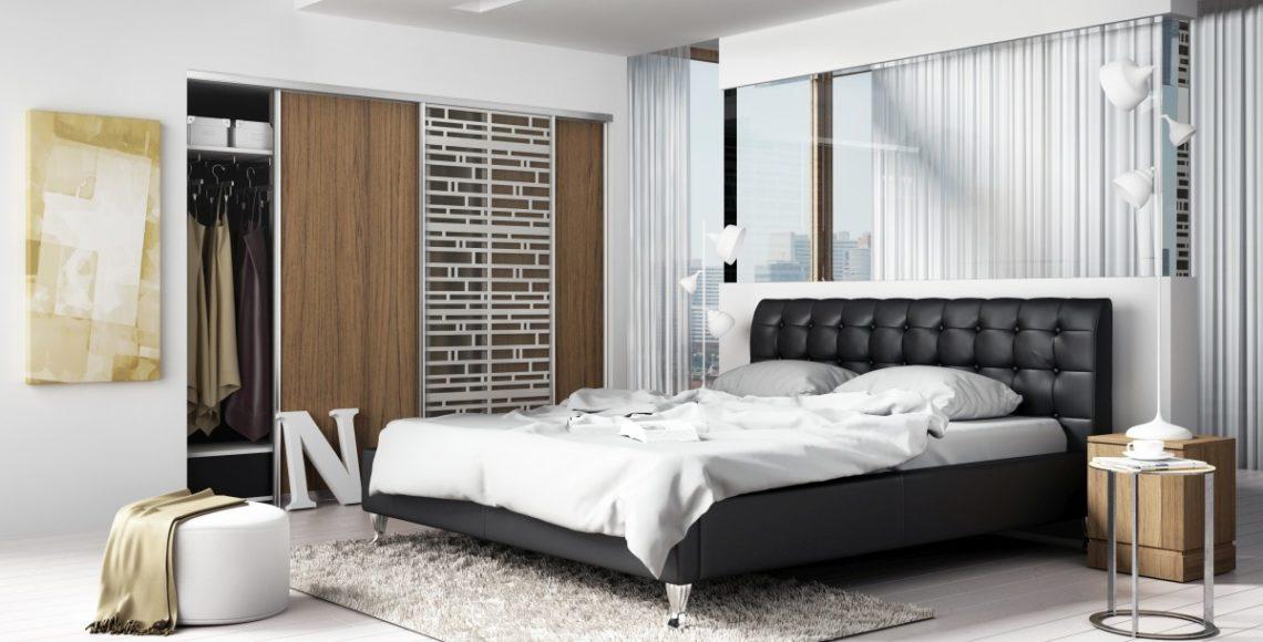 Tapicerowane łóżko glamour koloru czarnego idealne do sypialni
